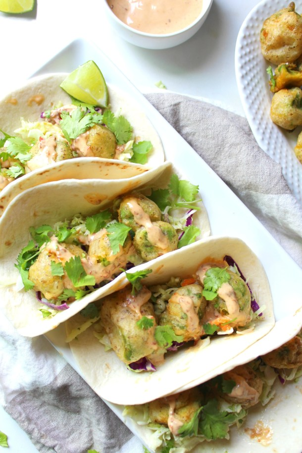 Take taco night to a whole new level with these Crispy Avocado Tacos with Vegan Chipotle Lime Aioli. Crispy, creamy and spicy! | ThisSavoryVegan.com