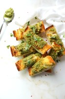 Take french bread to a whole new level with this Vegan Pesto Garlic Bread. A fun take on a classic side dish for your next BBQ! | ThisSavoryVegan.com