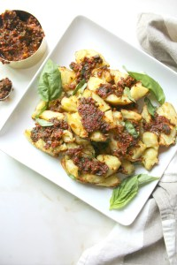 A tasty vegan appetizer or snack with a Mediterranean twist - Smashed Potatoes with Vegan Sun-Dried Tomato Pesto | ThisSavoryVegan.com