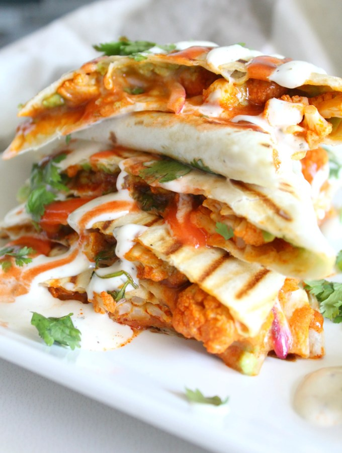 Spice up your next lunch with this Vegan Buffalo Cauliflower Quesadillas. A creamy, spicy combo of marinated cauliflower, vegan ranch and buffalo sauce | ThisSavoryVegan.com