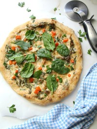 The perfect vegan pizza when you need something simple, comforting and delicious - Vegan Roasted Garlic and Spinach White Pizza | ThisSavoryVegan.com #vegan #veganpizza