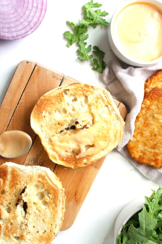 Switch up your typical breakfast with thisHash Brown Breakfast Bagel with Vegan Sriracha Mayo. A crunchy, spicy twist on a breakfast sandwich | ThisSavoryVegan.com #vegan #veganbreakfast