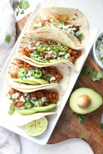 TheseMarinated Pinto Bean Tacos are healthy, vegan and super simple. With just a few ingredients and 30 minutes, you can have Taco Tuesday at home!   ThisSavoryVegan.com #vegan #vegantacos