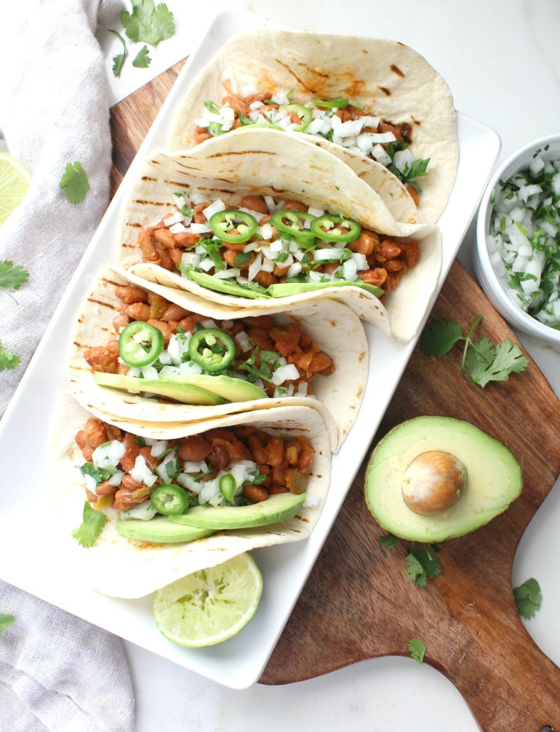 These Marinated Pinto Bean Tacos are healthy, vegan and super simple. With just a few ingredients and 30 minutes, you can have Taco Tuesday at home! | ThisSavoryVegan.com #vegan #vegantacos
