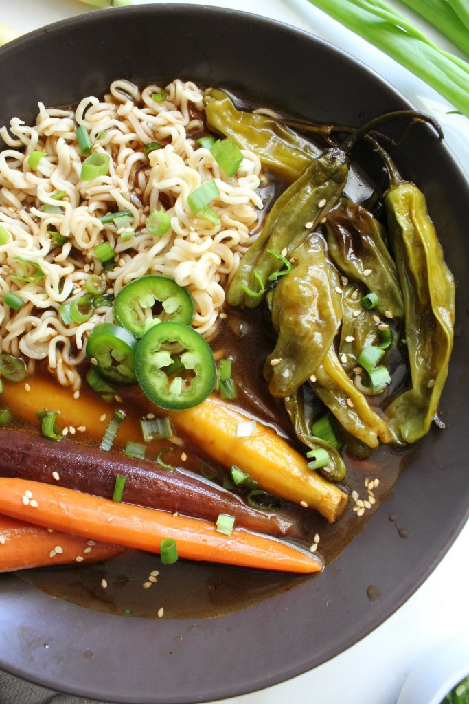 ThisRoasted Vegetable Vegan Ramen is bursting with flavor - roasted carrots and shishito peppers simmer in a vegan beef broth before being topped off with ramen noodles | ThisSavoryVegan.com #vegan #veganuary