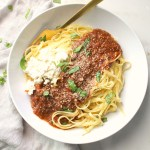 ThisSlow Cooker Mushroom Ragu with Vegan Ricotta combines simple ingredients to create a rich and flavorful vegan sauce with minimal effort. Serve over pasta for an easy weeknight dinner! | ThisSavoryVegan.com