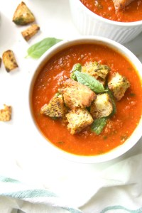 Say so-long to store bought soup with thisTomato Basil Soup with Pesto Ciabatta Croutons. Made simple by using canned tomatoes and made extra delicious with roasted garlic. A quick vegan recipe loaded with fresh flavors | ThisSavoryVegan.com #vegan #soup