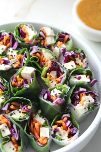 A simple lunch or dinner, these Vegan Rice Paper Rolls with Spicy Peanut Sauce are packed full of fresh veggies. Served with the best peanut sauce you've ever had! | ThisSavoryVegan.com #vegan #raw #mealprep