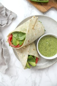 These Loaded Vegan Veggie Wraps with Chimichurri Dipping Sauce are the perfect on the go lunch. Packed with fresh veggies and served with an herb-filled sauce | ThisSavoryVegan.com #thissavoryvegan #backtoschool #veganlunch