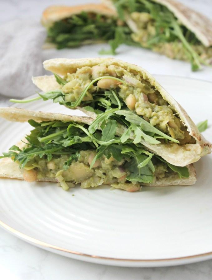 These Vegan White Bean Pesto Pitas are a creamy mixture of white beans, artichoke hearts, pesto and vegan mayo. These make a great make ahead lunch | ThisSavoryVegan.com #thissavoryvegan #mealprep #vegan