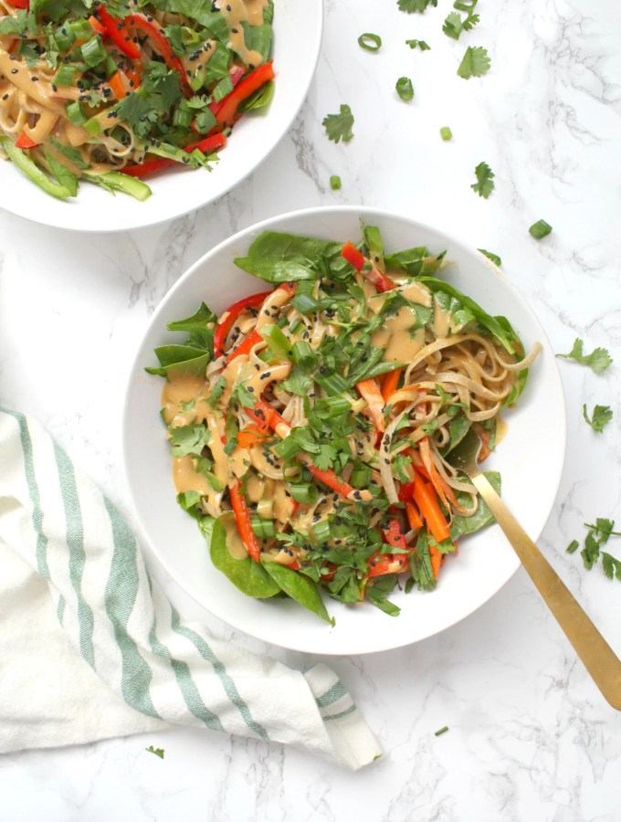Raw veggies are tossed together with rice noodles and a tahini dressing in these Asian Tahini Noodle Bowls. A quick vegan dinner or make ahead lunch | ThisSavoryVegan.com #thissavoryvegan #mealprep