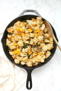 Make this Thanksgiving one to remember with this Vegan Sausage Kale Skillet Dressing. Filled with wilted kale, butternut squash and zesty vegan Italian sausage | ThisSavoryVegan.com #thissavoryvegan #veganthanksgiving #thanksgiving