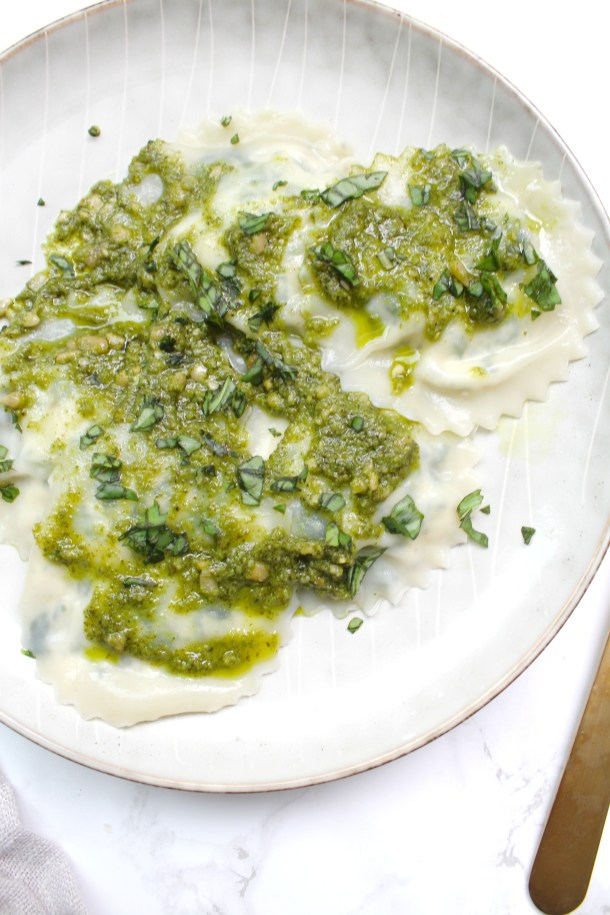 These Spinach Ricotta Vegan Ravioli are made easy by using pre-made wonton wrappers in place of pasta dough. Serve with your favorite sauce | ThisSavoryVegan.com #thissavoryvegan #veganravioli
