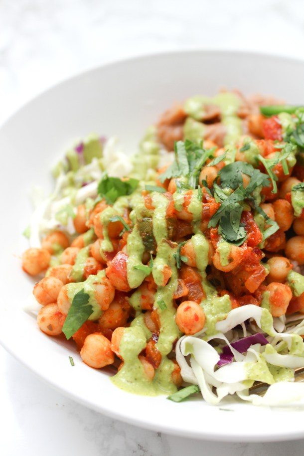 These Brown Rice Chickpea Taco Bowls with Jalapeño Cilantro Sauce are perfect for meal prep or an easy weeknight dinner | ThisSavoryVegan.com #thissavoryvegan #vegan #tacobowl
