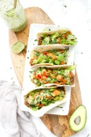 These Crispy Vegan Potato Tacos with Jalapeño Cilantro Sauce are filled with beans, crispy potatoes, crunchy lettuce and the best sauce   ThisSavoryVegan.com #thissavoryvegan #vegantacos #tacotuesday