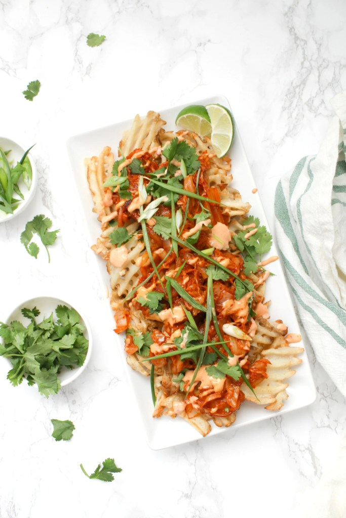 Loaded Vegan Kimchi Fries - crispy fries, sriracha mayo and zesty kimchi all topped off with tons of fresh cilantro and green onions | ThisSavoryVegan.com #thissavoryvegan #loadedfries