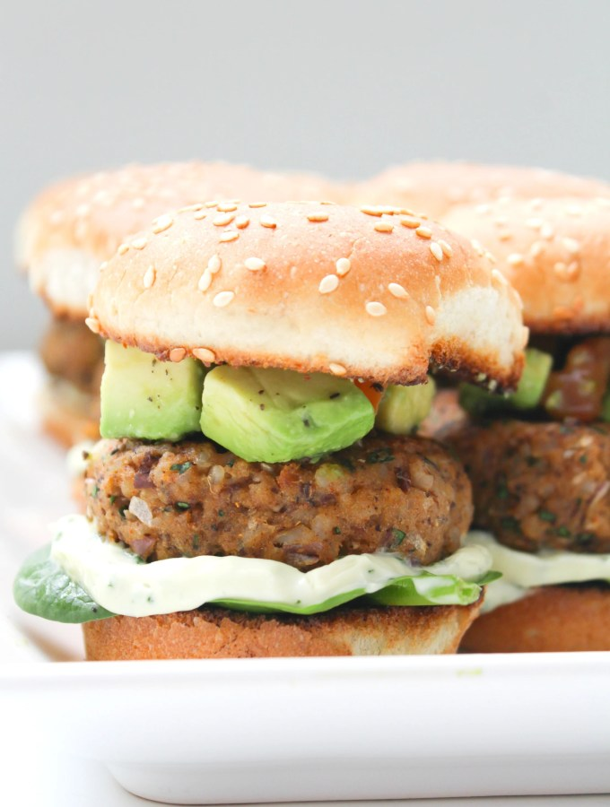 These Zesty Brown Rice Black Bean Vegan Sliders with Basil Aioli are the perfect party appetizer. Topped off with an avocado & tomato salsa   ThisSavoryVegan.com #thissavoryvegan #vegan #sliders