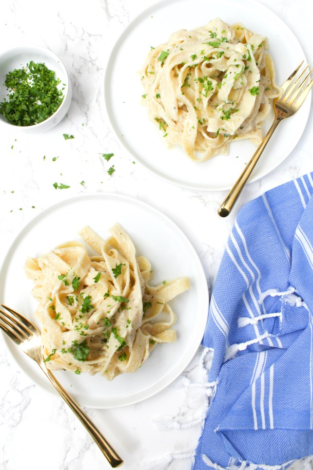 This Vegan Fettuccine Alfredo with Truffle Oil is the ultimate comfort meal. A creamy white wine sauce is combined with fettuccine noodles then topped with truffle oil   ThisSavoryVegan.com #thissavoryvegan #vegan #veganalfredo