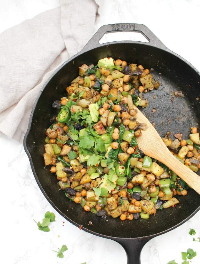 Make brunch at home with this Vegan Chickpea Potato Breakfast Hash - complete with crispy potatoes, chickpeas, bell peppers and avocado   ThisSavoryVegan.com #thissavoryvegan #vegan #veganbreakfast