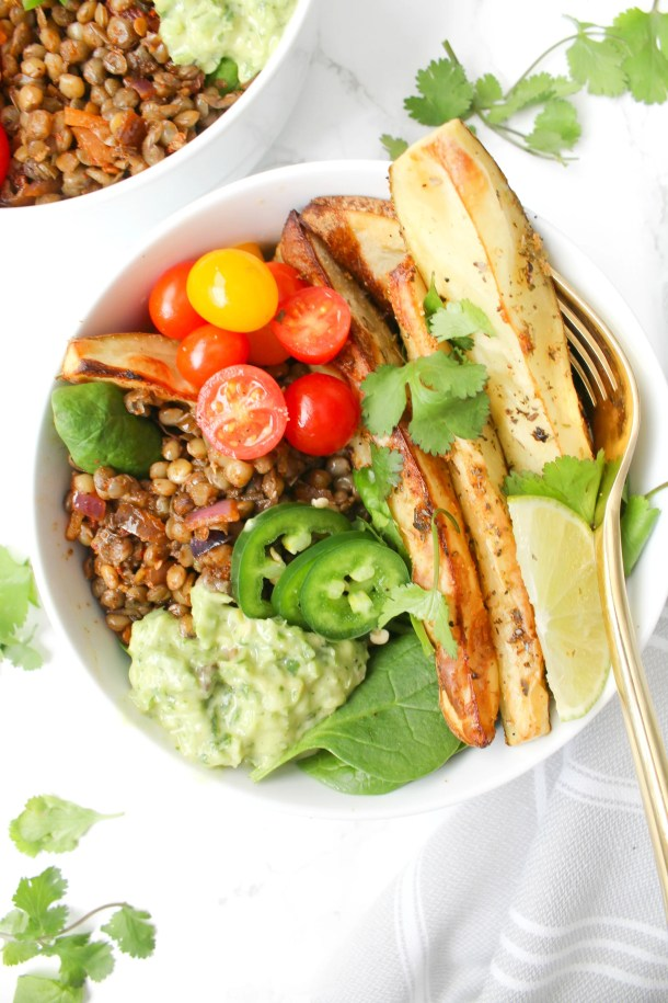 These Chipotle Lentil Potato Bowls with Creamy Dreamy Green Sauce have everything you could want in one meal - roasted veggies, fresh veggies, warm lentils and the best green sauce | ThisSavoryVegan.com #thissavoryvegan #vegan #veganbowl