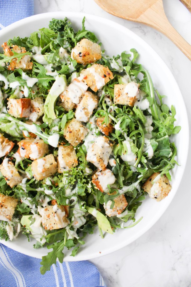 This Vegan Avocado Kale Caesar with Everything Bagel Croutons is going to be your go-to salad. Homemade croutons and the BEST tahini dressing | ThisSavoryVegan.com #thissavoryvegan #vegan #vegancaesar