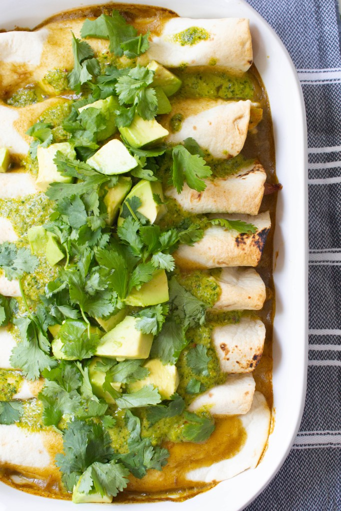 These Creamy Vegan Fajita Enchiladas are loaded with vegan cream cheese, bell peppers & onions, then topped with avocado, cilantro and green sauce   ThisSavoryVegan.com #thissavoryvegan #vegan #veganenchiladas