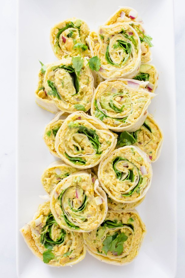 These Chickpea Salad Pinwheels are perfect for parties, lunches or just a good old snack. A healthy vegan meal that is super easy to make | ThisSavoryVegan.com #thissavoryvegan #vegan #pinwheelappetizer