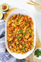 This Vegan Taco Pasta has all the flavor of traditional tacos, but in casserole form. This vegan dinner is packed with veggies, soyrizo and pasta shells | ThisSavoryVegan.com #thissavoryvegan #veganpasta #tacopasta