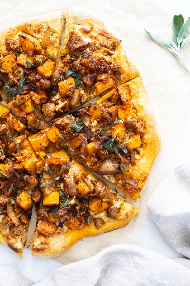 This Vegan Butternut Squash and Sausage Pizza is the ultimate Fall pizza recipe. Complete with a cream cheese sauce, caramelized onions & fried sage   ThisSavoryVegan.com #thissavoryvegan #veganpizza #veganfallrecipe