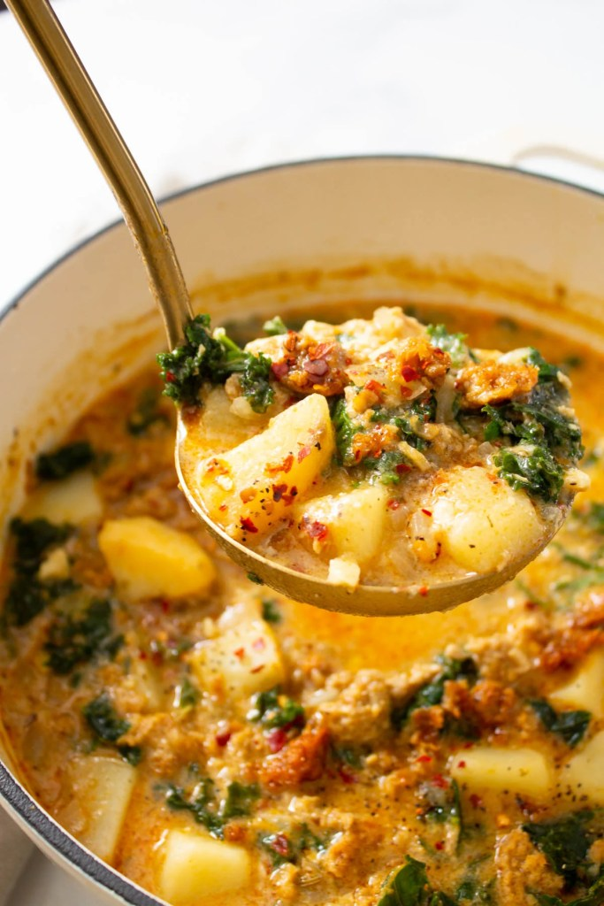 This Vegan Zuppa Toscana soup is perfectly creamy and comforting. Potatoes, vegan sausage and kale are loaded up in a super flavorful broth | ThisSavoryVegan.com #thissavoryvegan #vegansoup #zuppatoscana