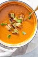 This Tomato Basil Soup with Vegan Grilled Cheese Croutons is made of a bunch of roasted veggies, basil pesto and the best croutons you've ever had | ThisSavoryVegan.com #thissavoryvegan #vegansoup #vegangrilledcheese