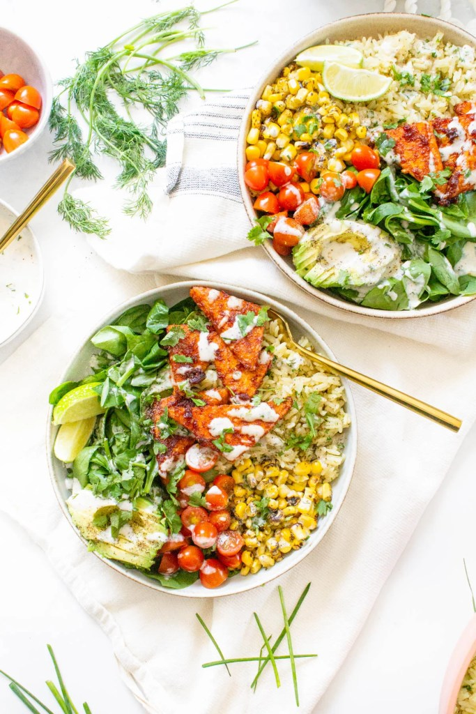 These BBQ Tempeh Bowls with Garlic Herb Rice are loaded with flavor-packed rice, corn, tomatoes, greens, crispy tempeh and vegan dressing. Perfect for meal prepping   ThisSavoryVegan.com #thissavoryvegan #veganbowls #bbqtempeh