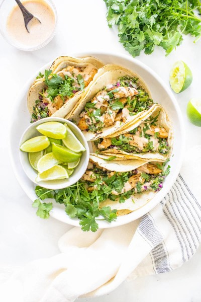 These Vegan Lemon Pepper Chicken Tacos are loaded with a kale avocado slaw and a chili lime crema. Perfect for your next Taco Tuesday | ThisSavoryVegan.com #thissavoryvegan #vegantacos #lemonpepperchicken