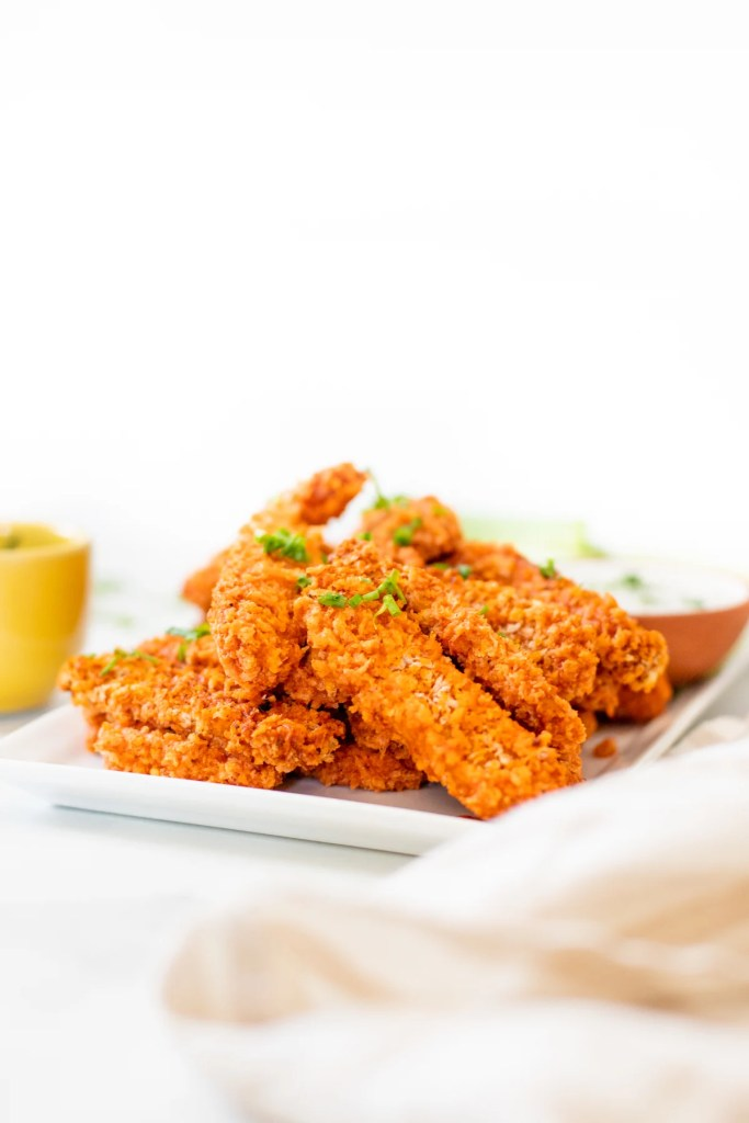 This Air Fryer Buffalo Tempeh is perfectly crispy & spicy. Serve as an appetizer with some vegan ranch or over a salad for a healthy dinner | ThisSavoryVegan.com #thissavoryvegan #airfryerrecipe #buffalotempeh