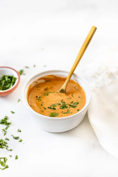 This Chipotle Ginger Cashew Dressing is zesty, creamy and totally tasty. Use this vegan dressing on salads, bowls or as a dipping sauce | ThisSavoryVegan.com #thissavoryvegan #cashewdressing #vegandressing