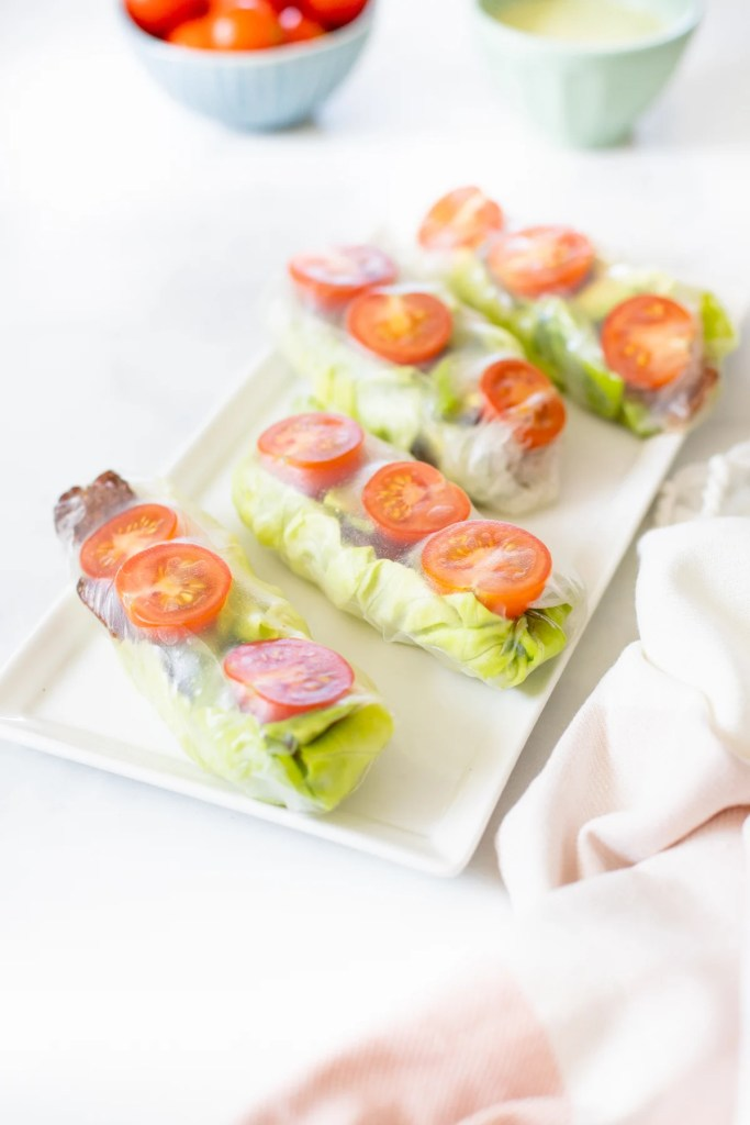 These Vegan BLT Summer Rolls are the perfect cold lunch or snack. Loaded with tempeh bacon, cherry tomatoes, butter lettuce & avocado. Served with Vegan Cilantro Ranch   ThisSavoryVegan.com #thissavoryvegan #summerrolls #veganblt
