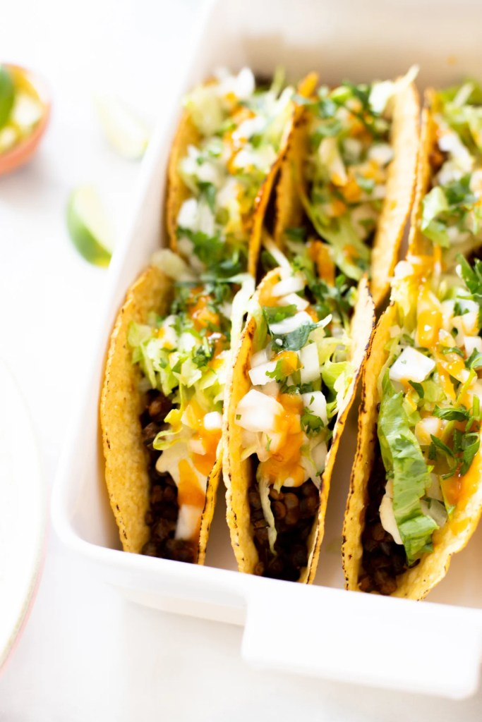 "These Vegan Oven Baked Tacos are the perfect weeknight dinner. Crispy taco shells are loaded with lentil taco ""meat"" and vegan queso 