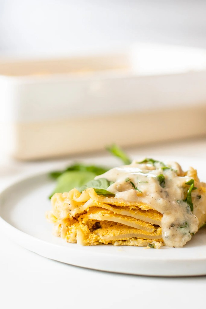 These Vegan Pumpkin Lasagna Roll Ups are filled with vegan ricotta, fresh herbs & pumpkin before being topped with a creamy vegan sauce! Perfect dinner for a cold night | ThisSavoryVegan.com #thissavoryvegan #veganlasagna #pumpkinlasagna