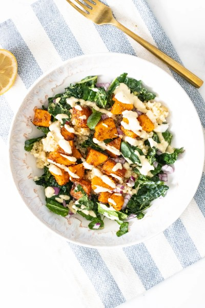These Butternut Squash Quinoa Bowls are a hearty, healthy and tasty meal. Filled with roasted veggies, marinated kale and a mustard tahini dressing   ThisSavoryVegan.com #thissavoryvegan #veganbowls #quinoarecipes