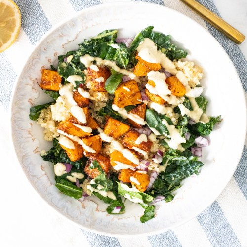 These Butternut Squash Quinoa Bowls are a hearty, healthy and tasty meal. Filled with roasted veggies, marinated kale and a mustard tahini dressing | ThisSavoryVegan.com #thissavoryvegan #veganbowls #quinoarecipes
