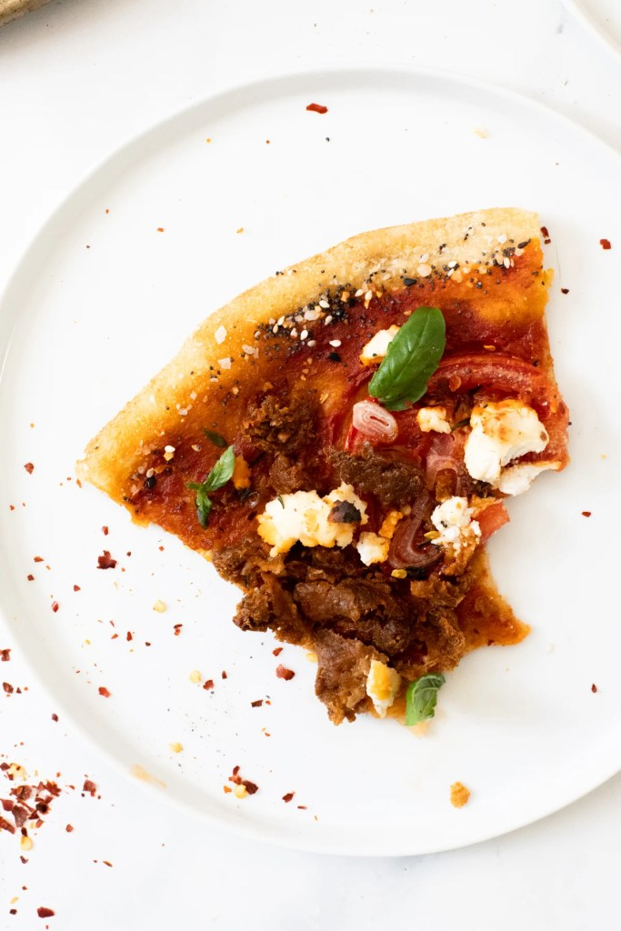 This Vegan Sausage & Ricotta Pizza has the perfect amount of crunch, spice and fresh flavors. A better than takeout vegan pizza you will want to make every Friday | ThisSavoryVegan.com #thissavoryvegan #veganpizza #vegandinner