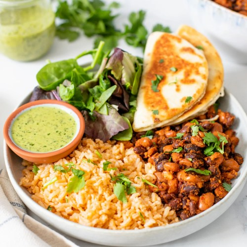These Vegan Bean & Rice Plates are a super simple dinner recipe that comes together in just 30 minutes. Served with mixed greens and mini quesadillas | ThisSavoryVegan.com #thissavoryvegan #riceandbeans #veganquesadillas