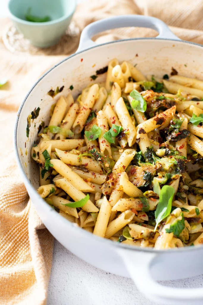 This Penne with Crispy Brussels Sprouts is a simple vegan pasta that is loaded with garlic, shallot, red pepper flakes & herbs | ThisSavoryVegan.com #thissavoryvegan #vegandinnerideas #veganpasta