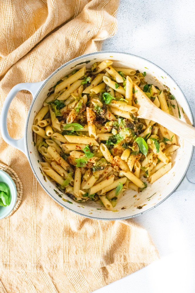 This Penne with Crispy Brussels Sprouts is a simple vegan pasta that is loaded with garlic, shallot, red pepper flakes & herbs   ThisSavoryVegan.com #thissavoryvegan #vegandinnerideas #veganpasta