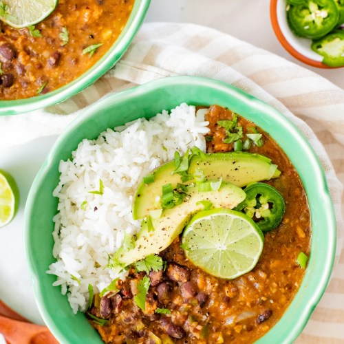 Perfect for a cold weeknight, this Slow Cooker Black Bean Soup is healthy, comforting and packed full of fiber and protein. Spice it up with your fave toppings | ThisSavoryVegan.com #thissavoryvegan #slowcookerrecipes #slowcookersoup