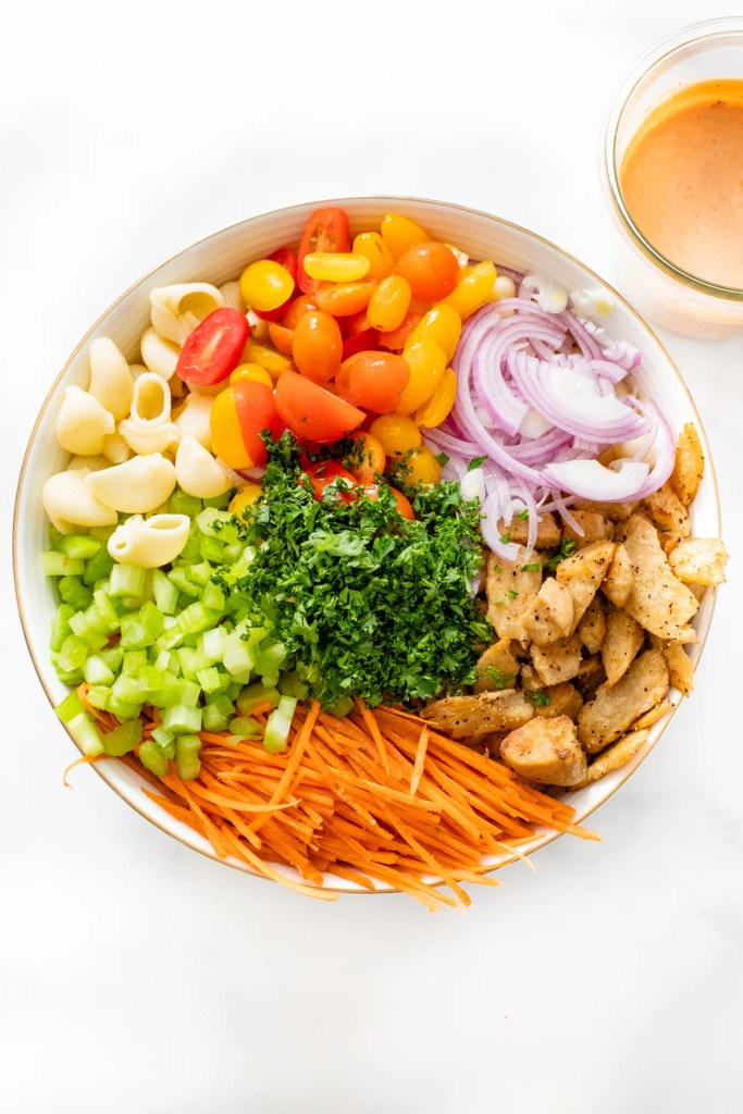 This Vegan Buffalo Chicken Pasta Salad is the perfect cold side dish. Crunchy veggies, charred vegan chicken and a zesty buffalo dressing | ThisSavoryVegan.com #thissavoryvegan #veganpastasalad #vegansidedish