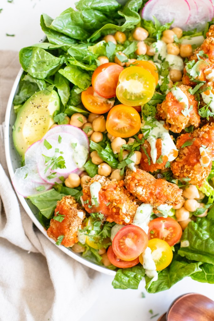 This Pretzel Crusted Buffalo Tempeh Salad has crunchy veggies, buffalo pretzel crusted tempeh and a creamy vegan ranch dressing. The perfect vegan salad | ThisSavoryVegan.com #thissavoryvegan #tempehrecipes #buffalosalad
