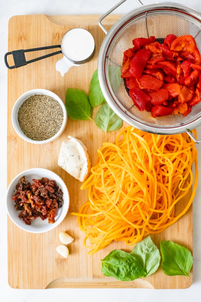 This Roasted Red Pepper Pasta is a quick vegan dinner that is made with spaghetti AND butternut squash noodles for some extra veggies | ThisSavoryVegan.com #thissavoryvegan #butternutsquashnoodles #vegandinner