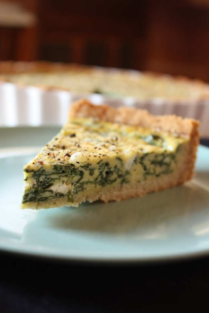 slice of gluten free spinach quiche on a plate