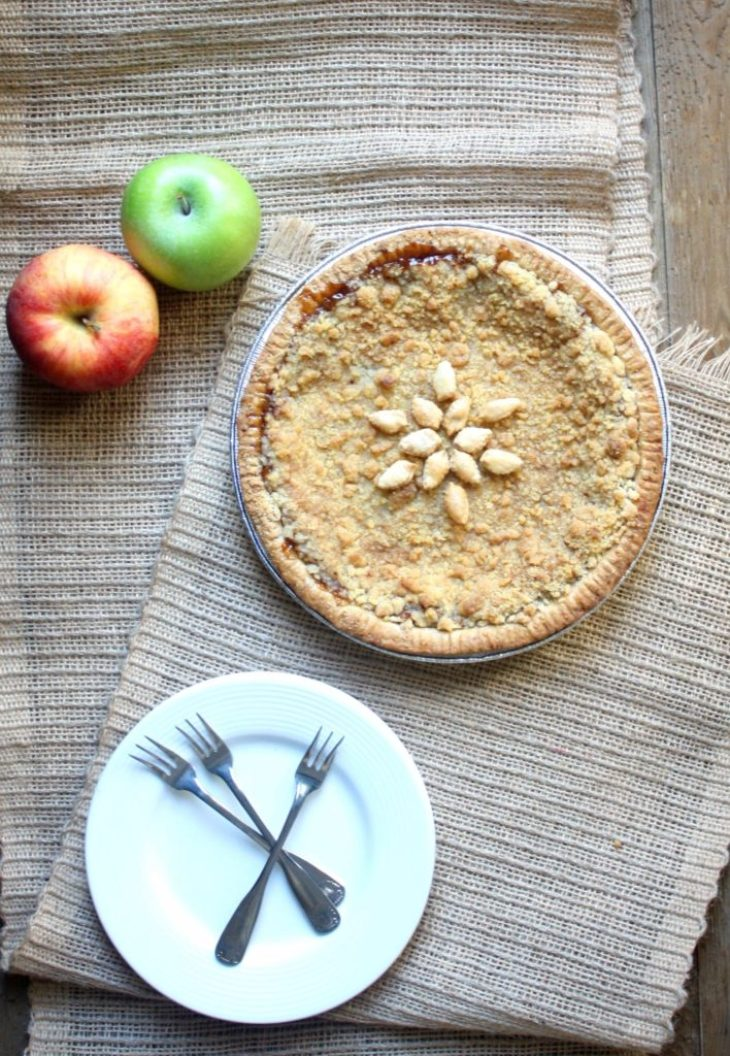 Apple caramel crumble pie with decorative apples and pie plates